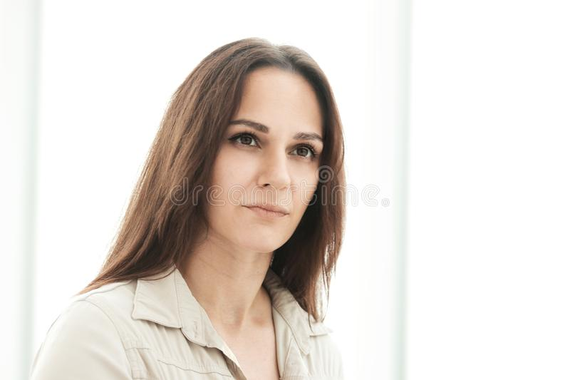 Close up.portrait of a modern businesswoman on the background of the office royalty free stock photography