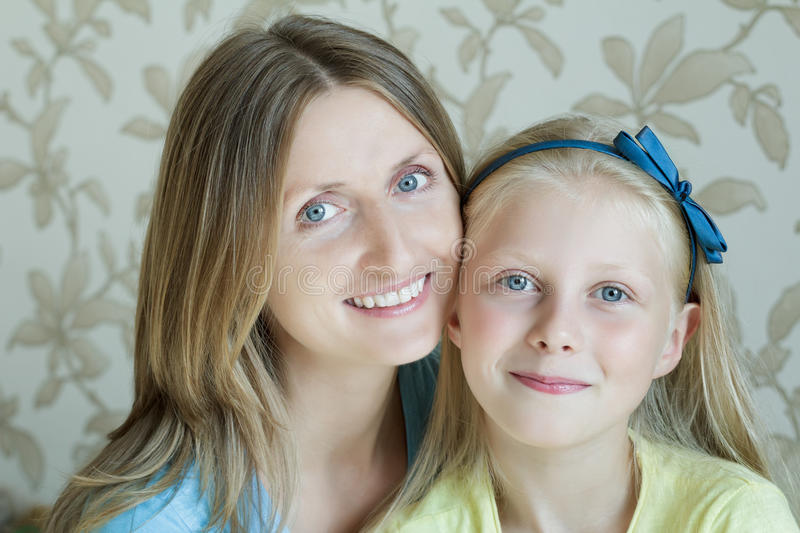 Close-up portrait of mother and her teenage daughter. Close-up portrait of mother and her blonde teenage daughter royalty free stock photos