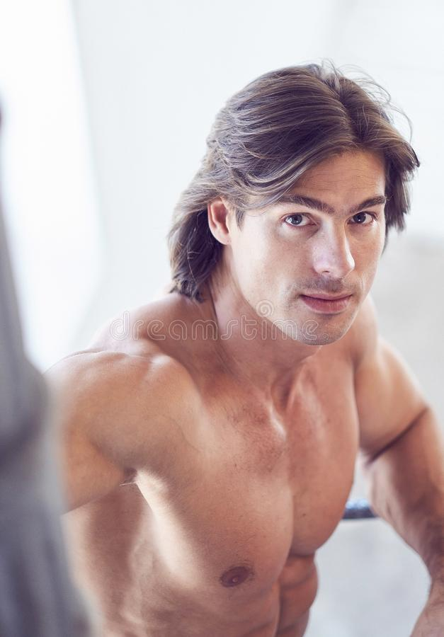 Close up portrait of muscular suntanned man. Close up portrait of muscular suntanned man in natural light royalty free stock image