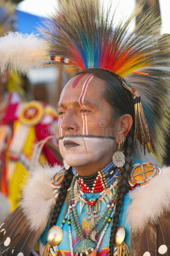 Close-up portrait of Native American in full regalia dancing at Pow wow stock images