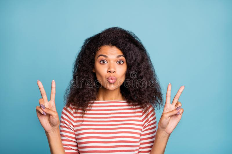 Close-up portrait of nice attractive lovely winsome wavy-haired girl wearing striped pullover showing double v-sign stock photography
