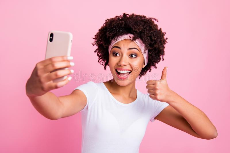 Close-up portrait of nice charming cute attractive lovely winsome cheerful cheery wavy-haired girl taking making selfie stock image