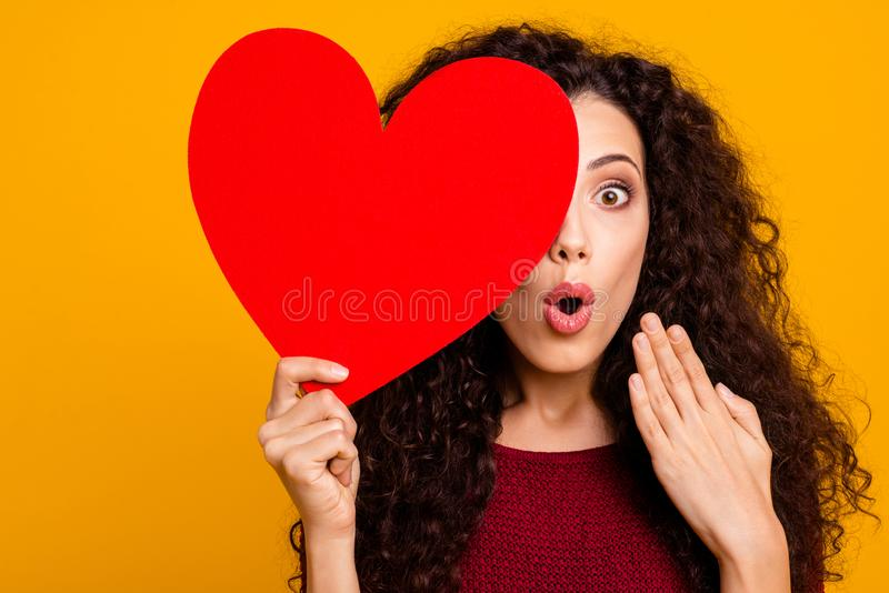 Close-up portrait of nice cute lovely attractive cheerful cheery funny wavy-haired lady holding in hand hiding behind royalty free stock images