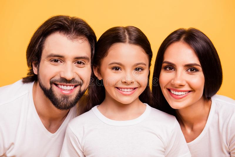 Close-up portrait of nice cute lovely winsome attractive charming cheerful people mommy daddy spending time pre-teen. Girl over shine vivid pastel yellow stock images