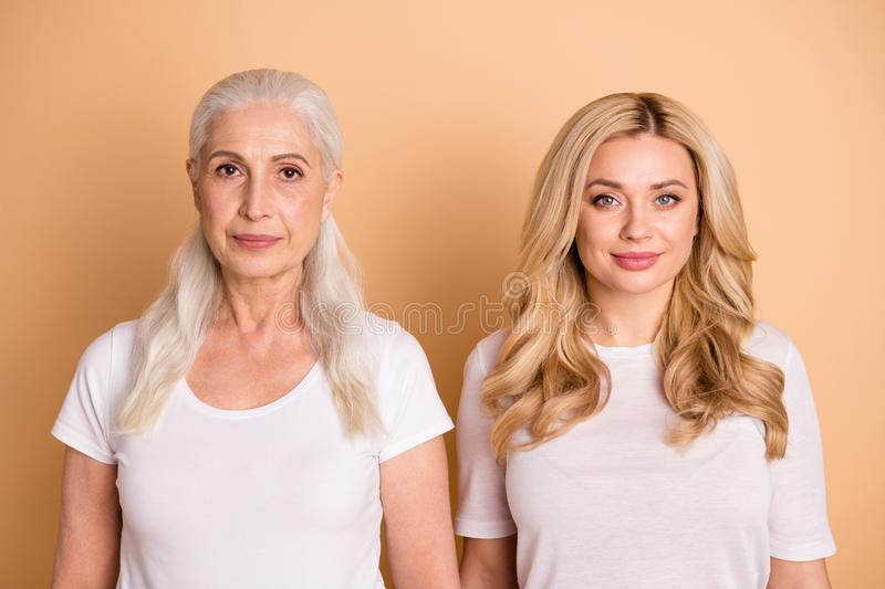 Close-up portrait of nice-looking well-groomed attractive lovely cute charming kind confident content ladies wearing royalty free stock images