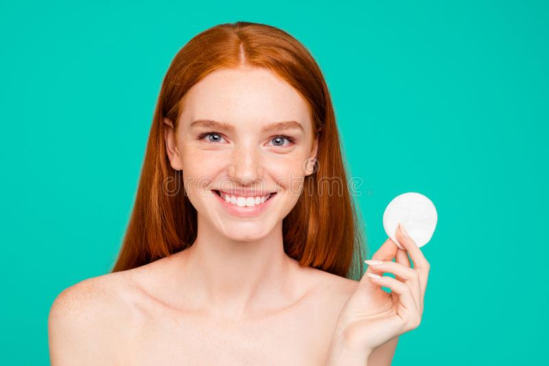 Close-up portrait of nice nude positive cheerful red-haired girl royalty free stock image