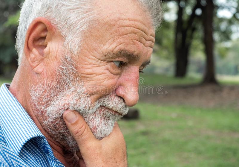 Close-up portrait of old man standing thinking, emotions and feelings royalty free stock photo