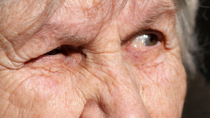Close-up portrait of a old woman`s gaze. Emotions of grandmother royalty free stock images
