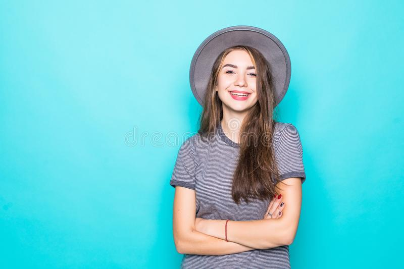Close up portrait of oung woman in hat  over blue background. Portrait of oung woman in hat  over blue background royalty free stock photography