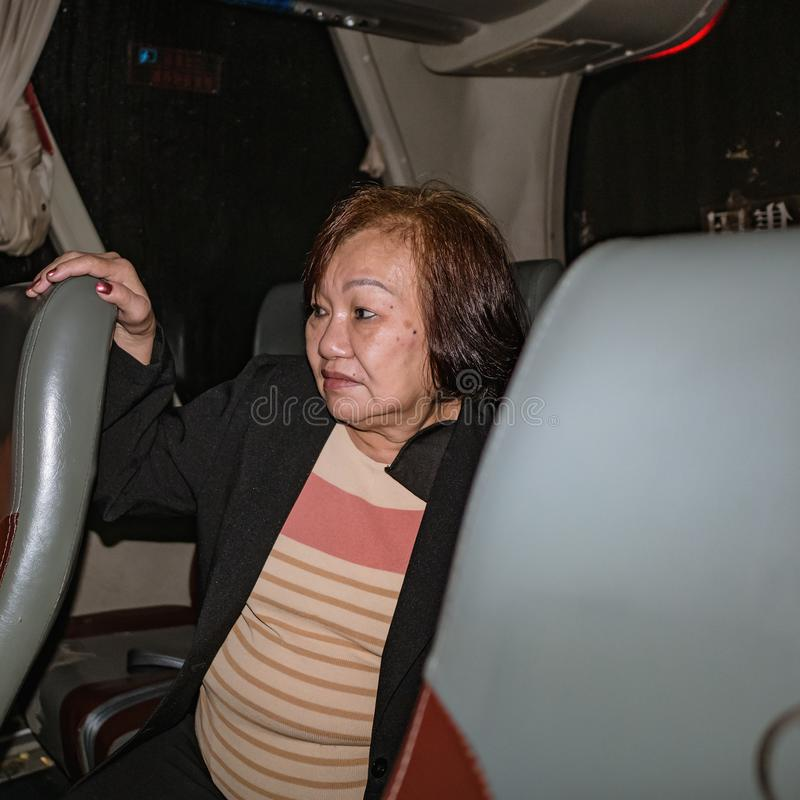 Close up portrait Photo of Senior asian women in the bus at changsha city china stock photography