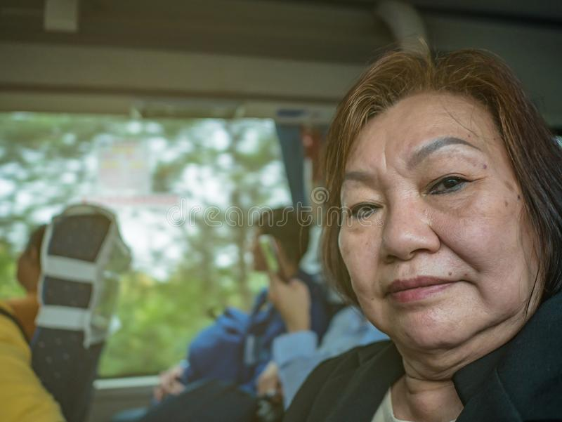 Close up portrait Photo of Senior asian women in the bus at changsha city china royalty free stock photos