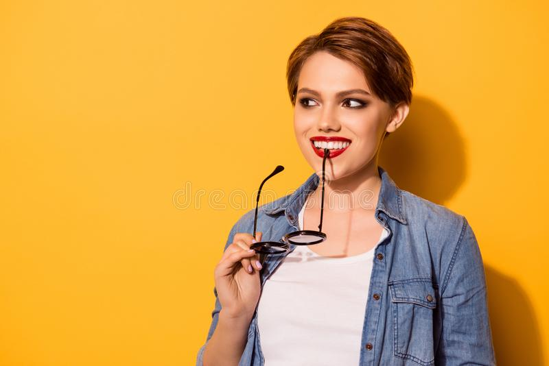 Close up portrait of a playful young stylish girl. She is in a j royalty free stock image