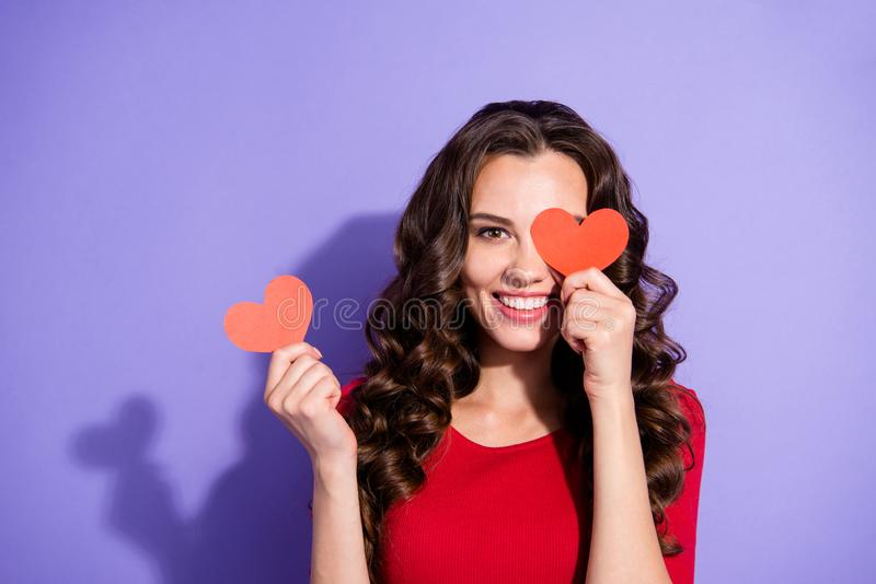 Close up portrait of pretty attractive she her girl holding two stock image