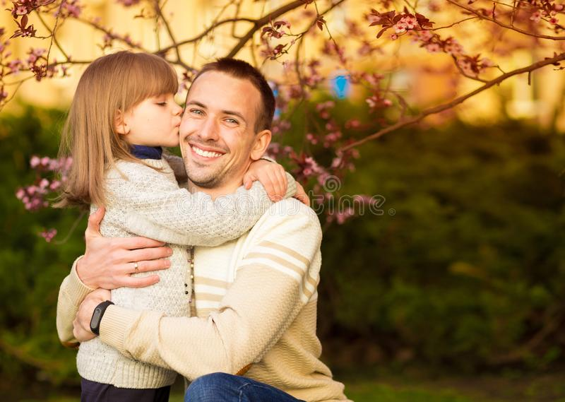Close up portrait pretty daughter embracing Caucasian father. Family enjoy spend time together. royalty free stock photography