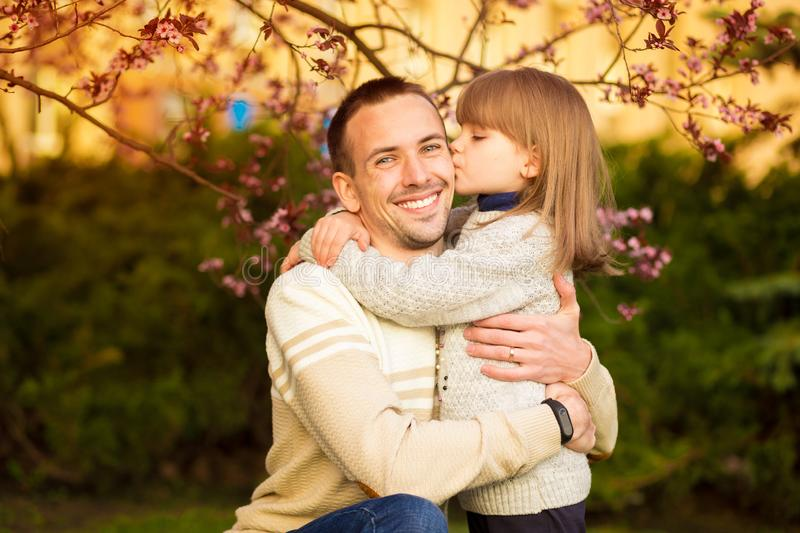 portrait pretty daughter embracing Caucasian father. Family enjoy spend time together. Happy diverse family royalty free stock image