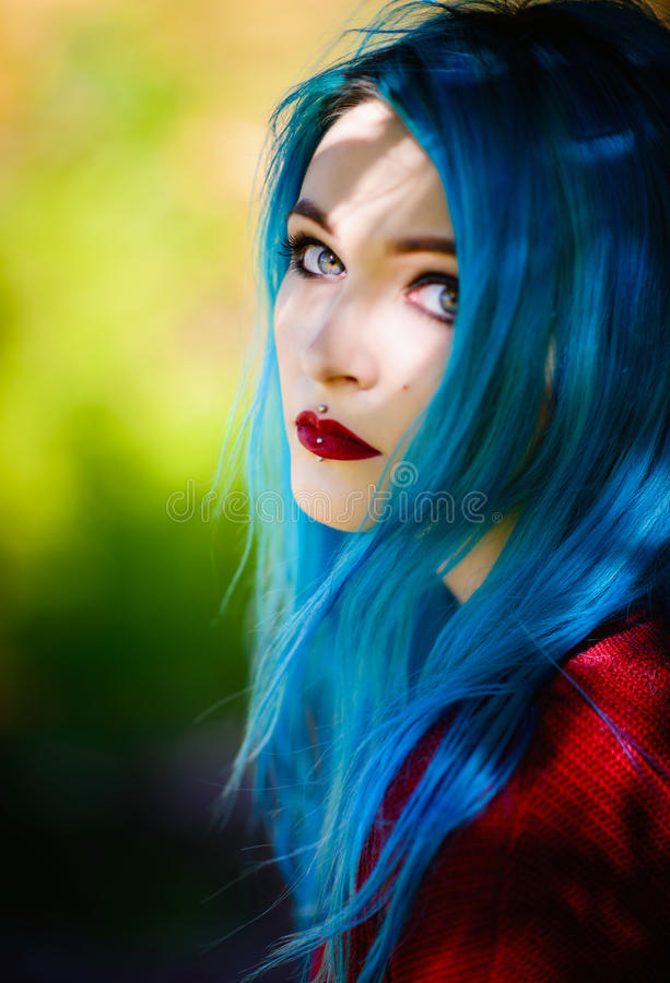 Close-up portrait of pretty young girl with blue hair stock photo