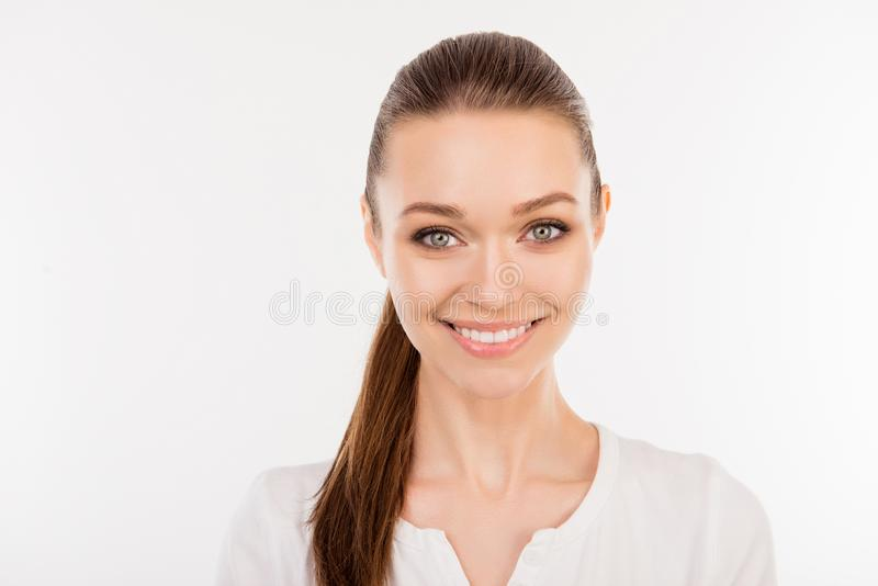 Close up portrait of pretty young smiling woman with ponytail is stock photos