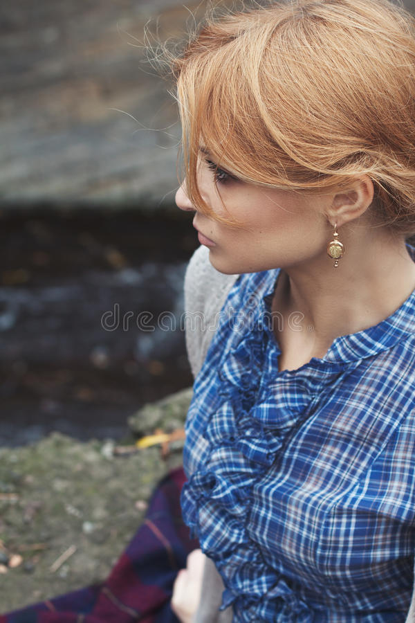 Close-up portrait in profile of woman in retro style outdoor. Close-up portrait in profile of beautiful girl in vintage style on nature background stock image