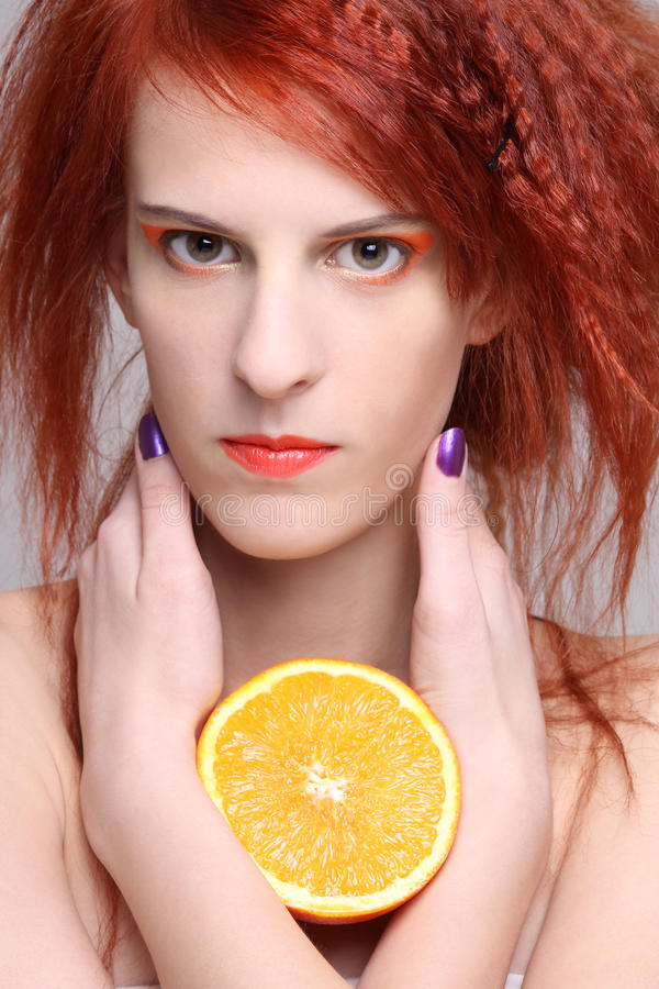 Download Close Up Portrait Of Redhaired Woman With Orange Half Stock Image - Image: 28624031