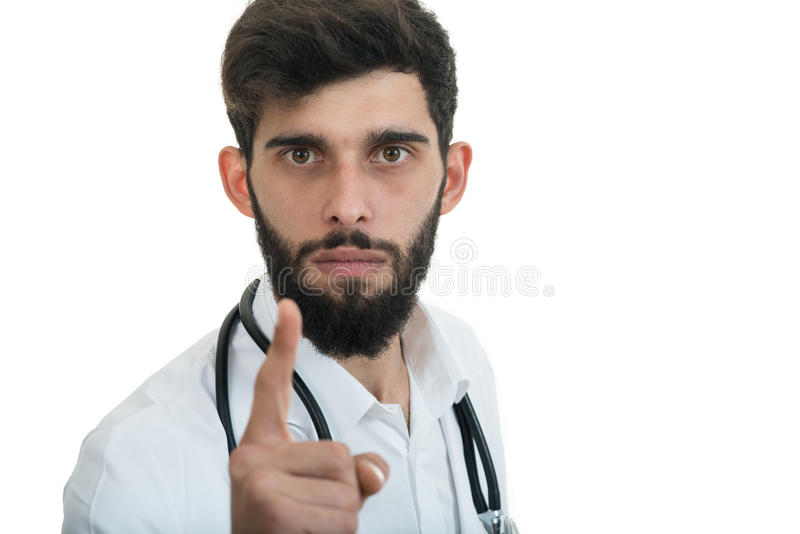 A close-up portrait of a rude, frustrated, upset doctor isolated on a white background stock photo