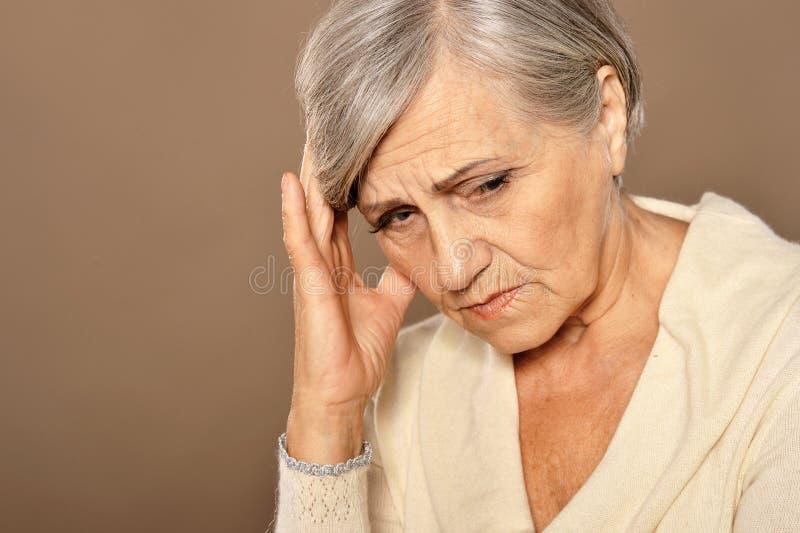 Close up portrait of sad beautiful senior woman royalty free stock photography