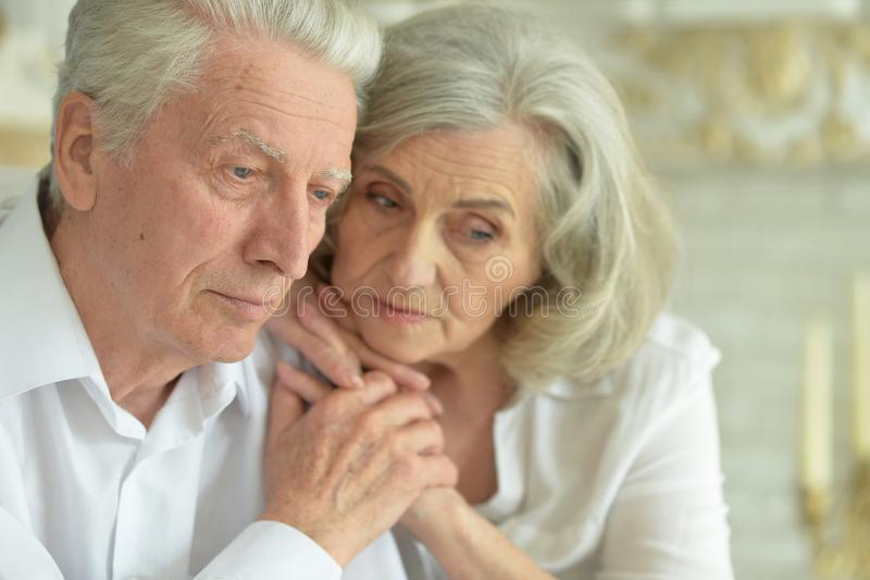 Close up portrait of sad senior couple at home royalty free stock photo