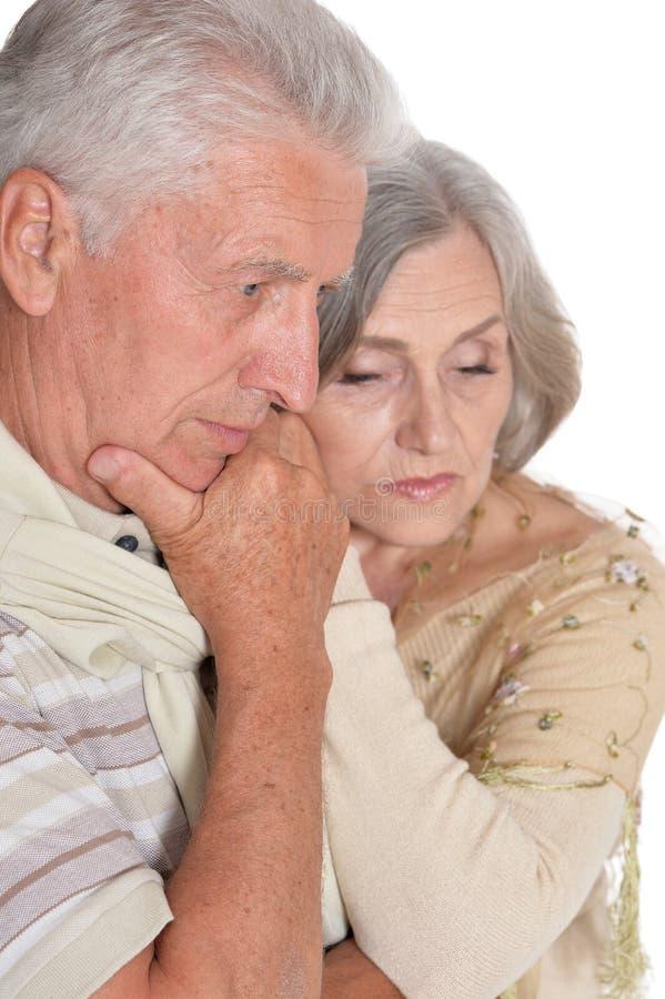 Close up portrait of sad senior couple royalty free stock photo
