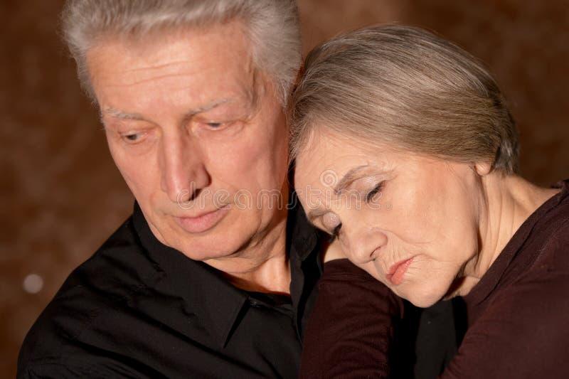 Close up portrait of sad senior couple posing at home royalty free stock photos