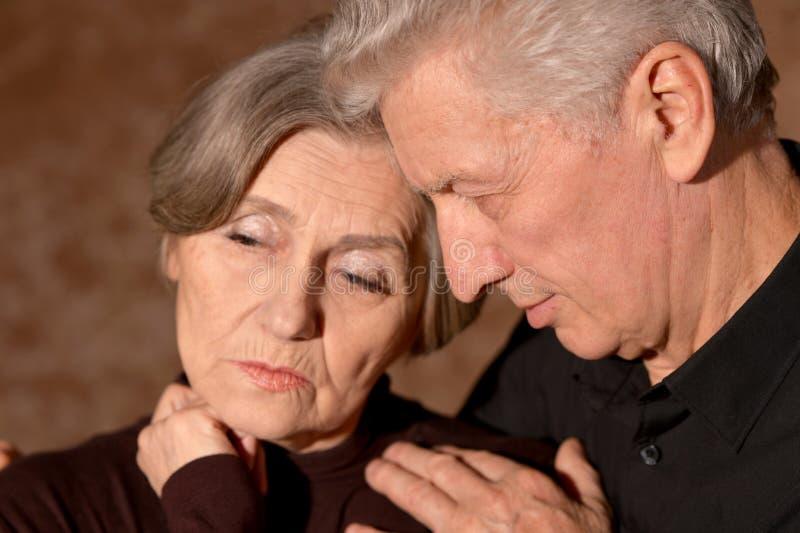 Close up portrait of sad senior couple posing at home royalty free stock photo