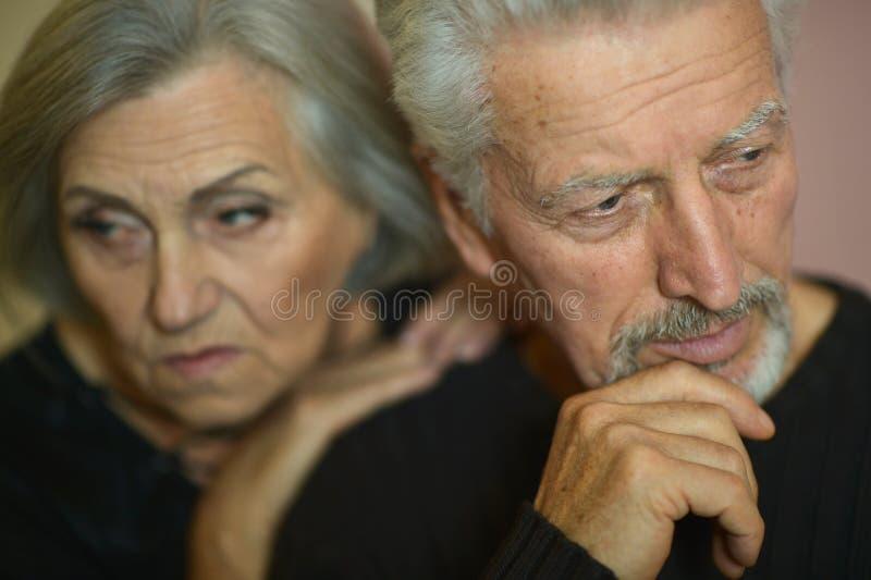 Portrait of sad senior couple posing at home royalty free stock photo