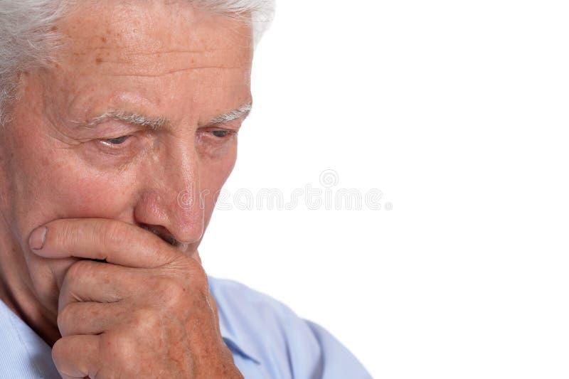 Close up portrait of sad senior man isolated on white background royalty free stock images