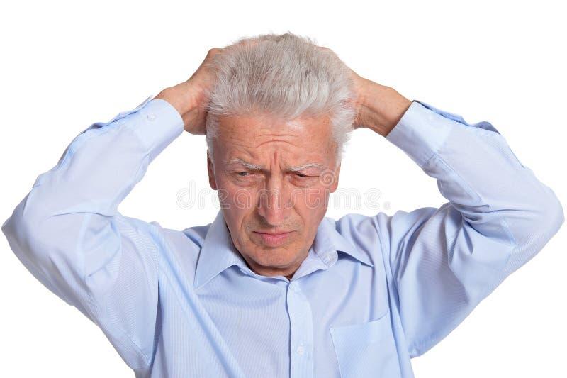 Close up portrait of sad senior man isolated on white background stock photo