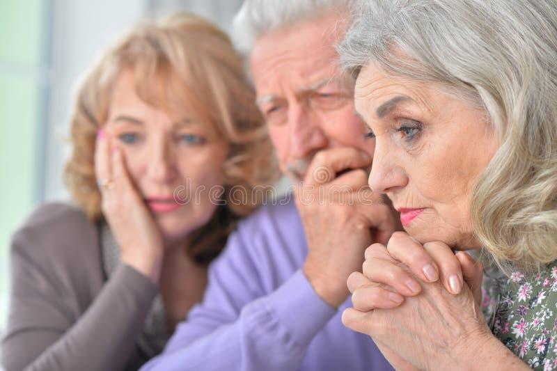 Close up portrait of sad senior people stock photo