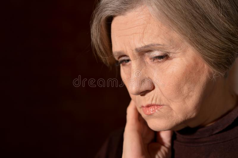 Close up portrait of sad senior woman royalty free stock photography