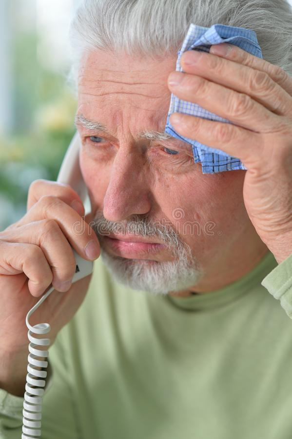Close up portrait of sad sick senior man royalty free stock image
