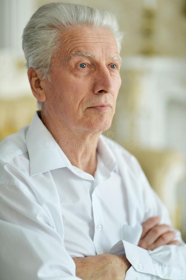 Close up portrait of sad thinking senior man royalty free stock photo