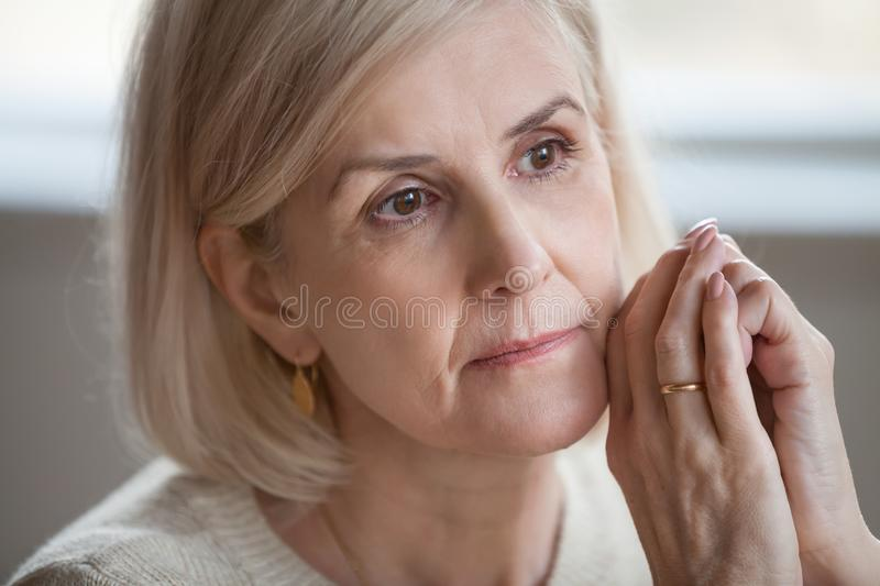Close up portrait sad thoughtful attractive old woman stock photo
