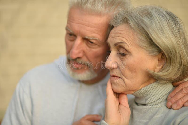 Close up portrait of sad thoughtful senior couple royalty free stock photo