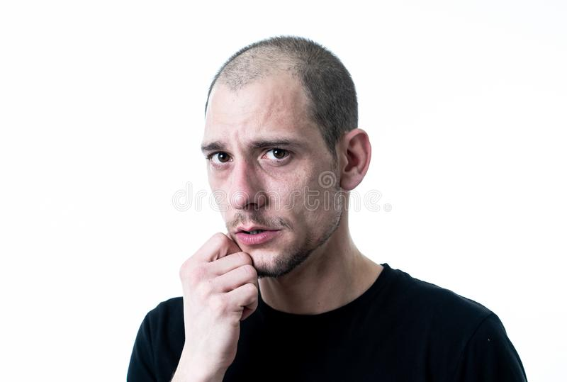 Close up portrait of sad young man face suffering from depression, stress and unhappiness royalty free stock images