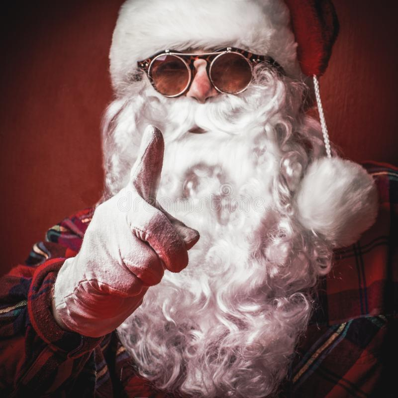 Strict Santa Claus with a gesture of finger and sunglasses, close-up stock photography
