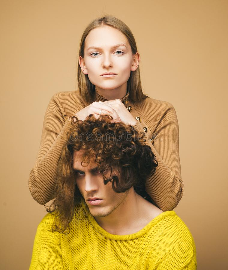 Close up portrait self-confident young woman and serious dissatisfied man with stylish hairstyle. Attractive couple royalty free stock photo