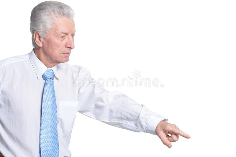 Close up portrait of senior businessman in formal wear pointing stock images