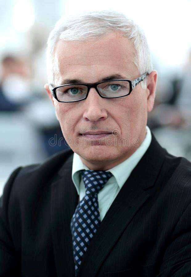 Close up portrait of senior businessman in office stock image