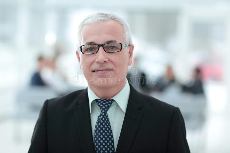 Close up portrait of senior businessman in office stock photography