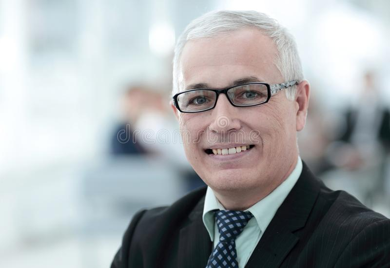 Close up portrait of senior businessman in office stock images