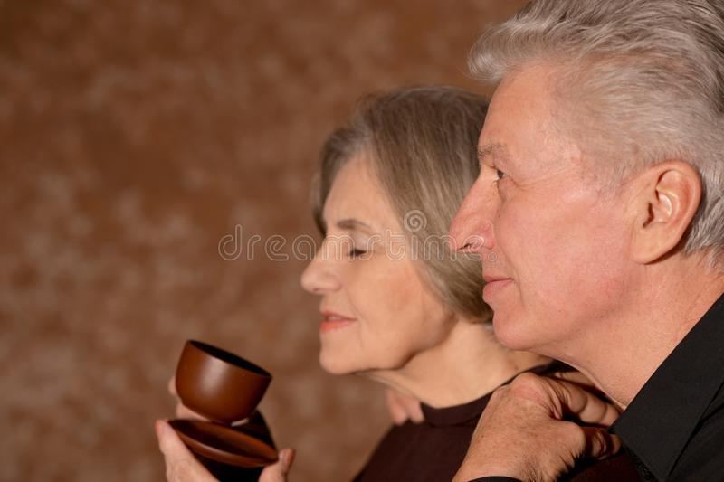 Close up portrait of senior couple posing with cup of coffee stock photos