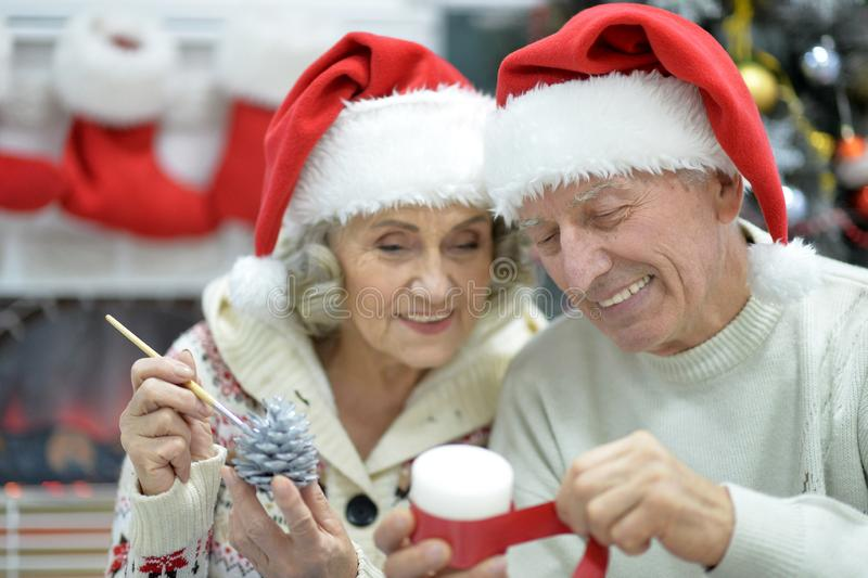 Close up portrait of senior couple preparing for Christmas royalty free stock images