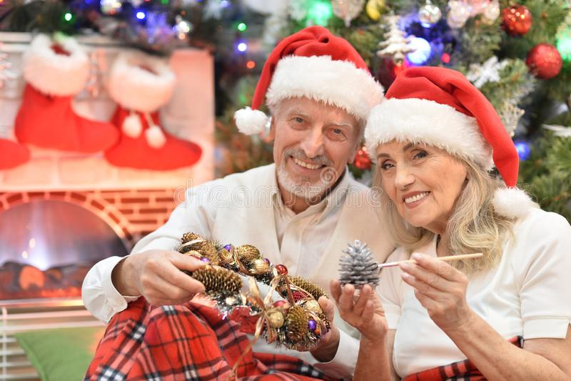Close up portrait of senior couple preparing for Christmas royalty free stock photos