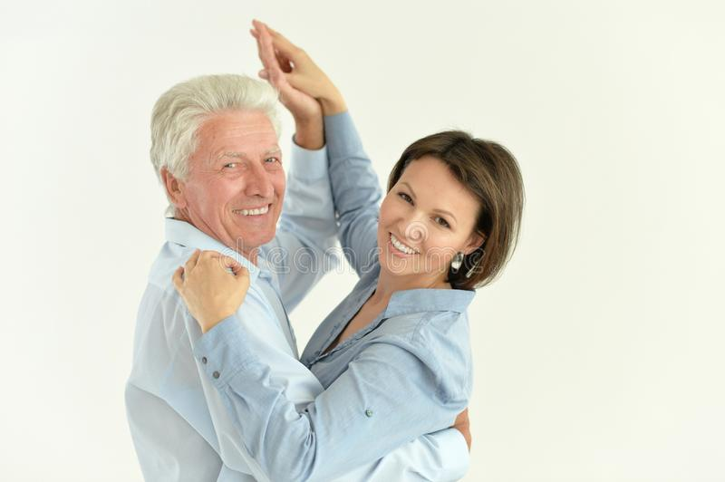 Portrait of senior man with adult daughter dancing. Close up portrait of senior men with adult daughter dancing royalty free stock images
