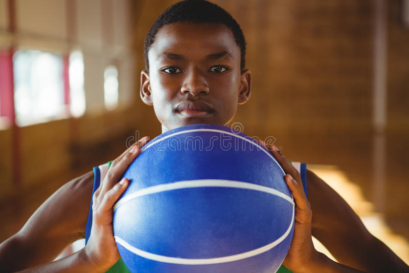 Close up portrait of serious man with basketball royalty free stock image